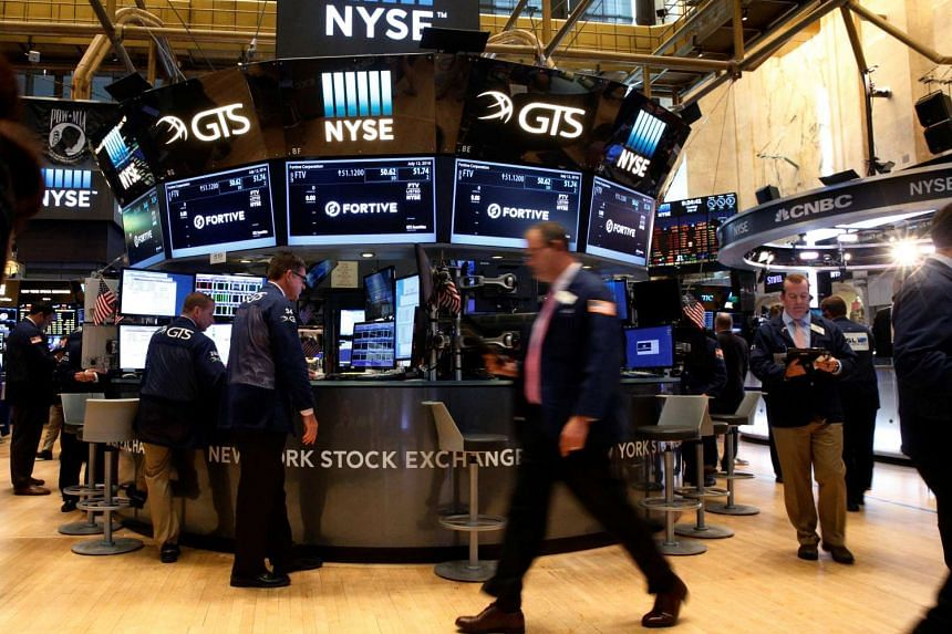 Traders work on the floor of the New York Stock Exchange (NYSE) on Tuesday.