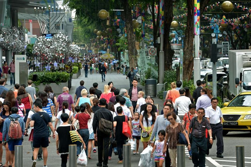 Shoppers walking along Orchard Road near Takashimaya.