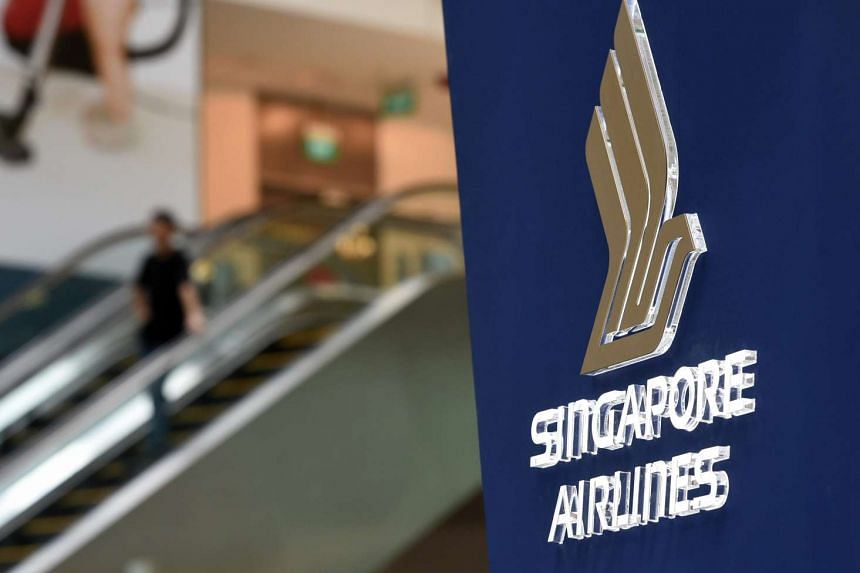 The Singapore Airlines logo pictured at a promotional booth at Changi Airport.