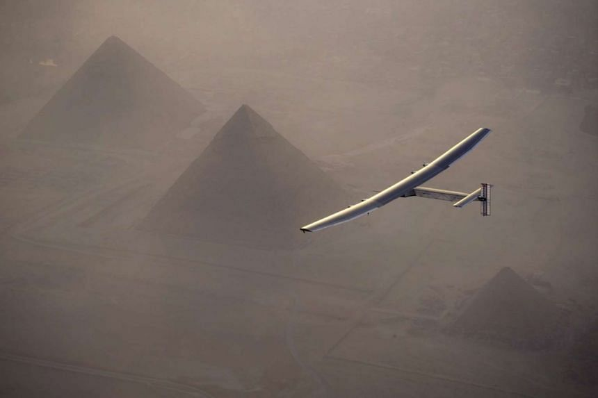 Solar Impulse 2, the solar powered plane, piloted by Swiss pioneer Andre Borschberg is seen during the flyover of the pyramids of Giza on July 13, 2016 prior to the landing in Cairo, Egypt in this photo released on July 13, 2016.
