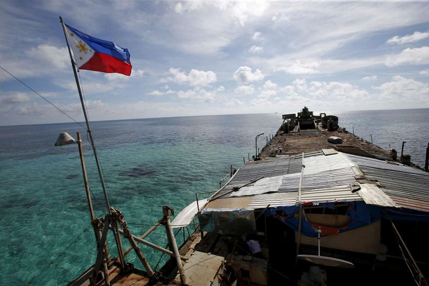 A Philippine flag flutters from BRP Sierra Madre, a dilapidated Philippine Navy ship in the South China Sea.