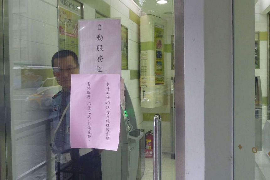 A notice telling customers at a Taipei branch of Taiwan's First Commercial Bank that ATM services have been suspended. The island's top eight banks took the precaution following the discovery on Monday that thieves had hacked 34 ATMs at 20 branches of Fir