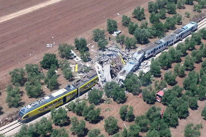 An aerial view of the site where two trains collided on a single-track stretch in countryside between the towns of Corato and Andria in Puglia, southern Italy, yesterday.