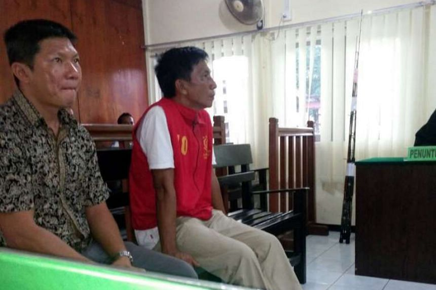 Mr Choo (right), accompanied by a Chinese-language translator in court. He had been arrested in Indonesian waters on April 16, together with 13 passengers.