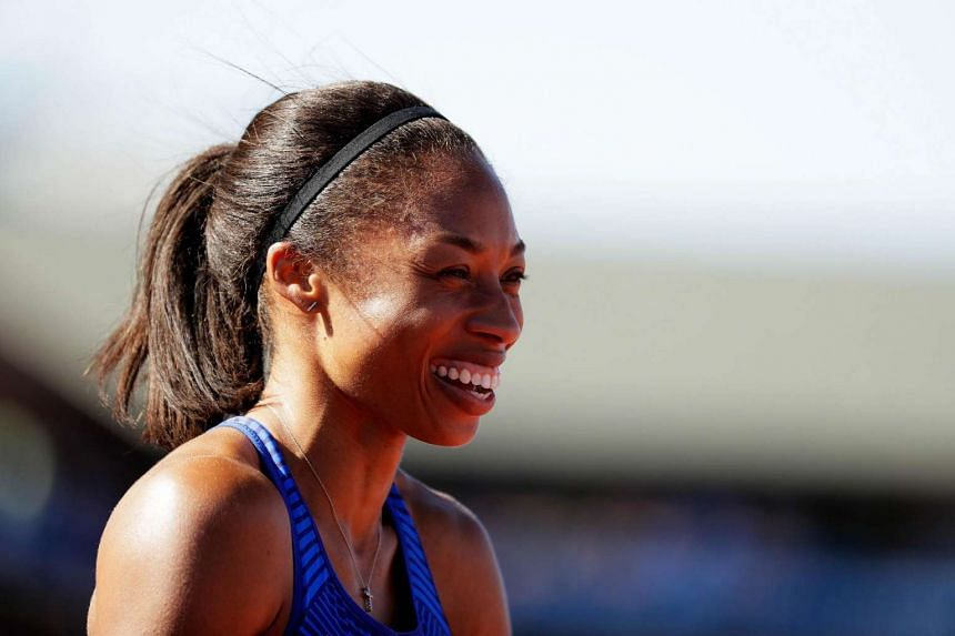 Allyson Felix celebrates after placing first in the women's 400m final at the 2016 US Olympic Track & Field Team Trials, on July 3, 2016.