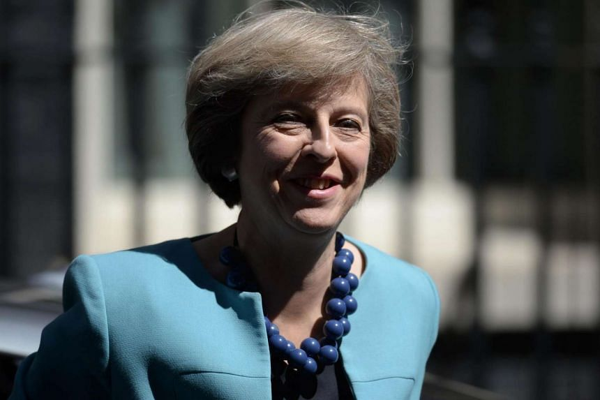 British Prime Minister Theresa May arrives at 10 Downing Street in central London on July 14, 2016.