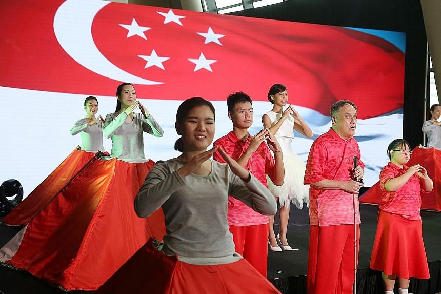 """Special needs participants and Singapore Soka Association performers singing the song Home at a media preview. The Aug 9 event will have, for the first time, """"song signing"""". Led by sign language instructor Neoh Yew Kim, the audience will be invited t"""