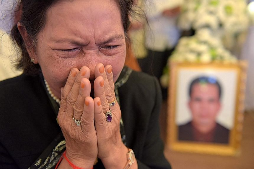 A woman mourning pro-democracy campaigner Kem Ley, who was killed on Sunday, at his funeral in Phnom Penh on Tuesday. The suspect claimed he shot Mr Kem Ley over an outstanding debt.