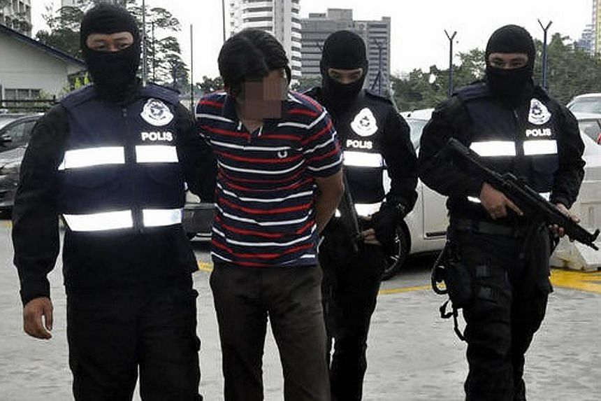 Malaysian police arresting a suspect believed to be linked to terrorist group ISIS. Malaysia is on tenterhooks over security fears following a grenade attack on a nightclub in Selangor more than two weeks ago by ISIS sympathisers.