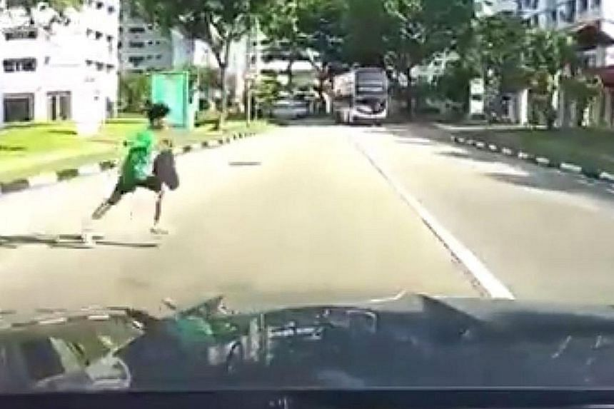 "Video footage uploaded to social media shows the primary school boy dashing across the road (left) and being hit by a car. He did not appear to be seriously hurt. The boy's school, which declined to be named, said he ""received treatment in the hospit"