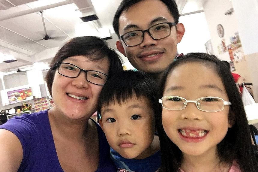 Mr Low with his wife, Ms Elaine Chow, and two of their children, David and Emma.
