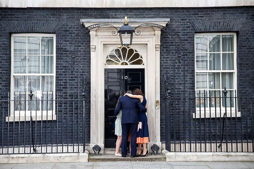 Mr Cameron sharing an embrace with his wife Samantha and children Nancy, Elwen and Florence outside No. 10 Downing Street, the official residence of the British Prime Minister, yesterday.