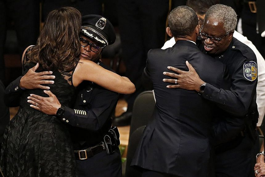 Dallas Police Department Chief David Brown (at left) and Dallas Area Rapid Transit Police Chief J.D. Spiller with the First Couple during the Interfaith Tribute to Dallas Fallen Officers at the Morton H. Meyerson Symphony Centre on Tuesday.