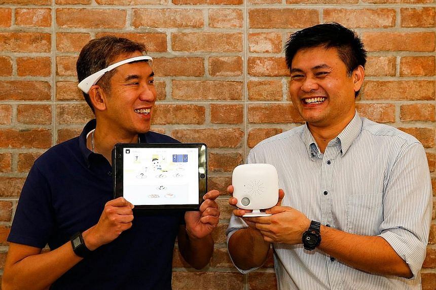 Dr Chan (left) wears Neeuro's SenzeBand on his head. It can detect brainwaves, allowing him to control his brain activity to play games meant to improve memory, spatial skills and other cognitive functions. Dr Tan's SoundEye Ark device was originally