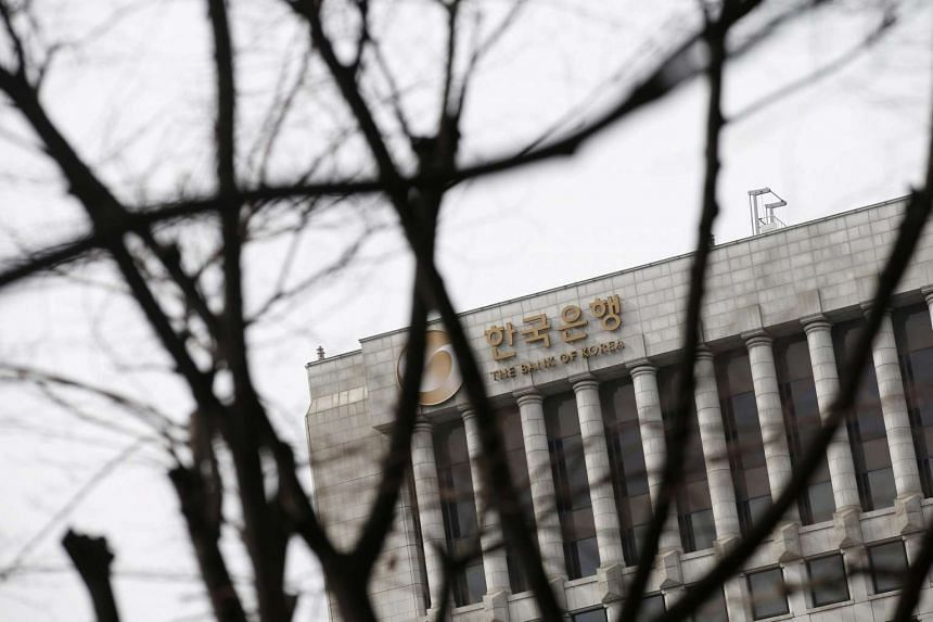 The logo of the Bank of Korea is seen on the top of its building in Seoul, South Korea, on March 8.