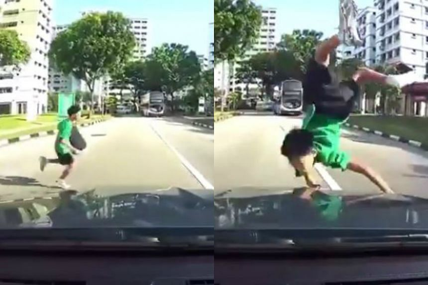 The boy was sent flying by an oncoming car after he dashed onto the road, with the driver's view obscured by a bus.