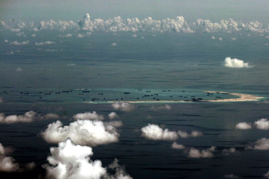 This file aerial photo taken on May 11, 2015, shows alleged on-going reclamation by China on the Mischief Reef in the Spratly group of islands in the South China Sea.