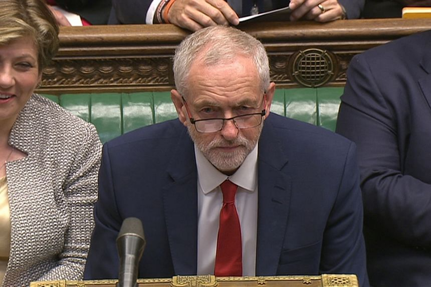 Britain's opposition Labour party leader, Jeremy Corbyn (centre), in the House of Commons, in central London, Britain, on July 13.
