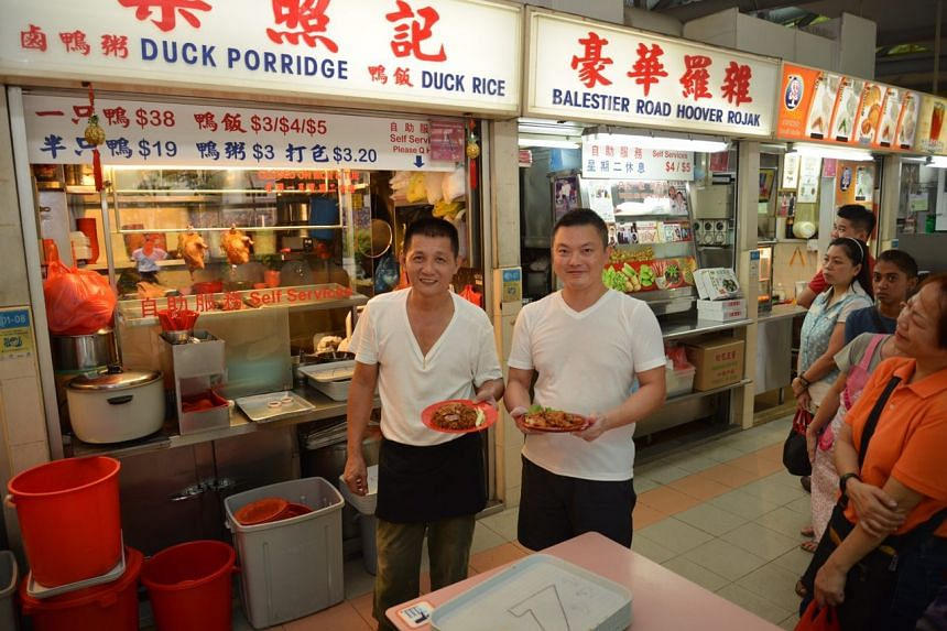 Mr Low Ah Leng (left), the co-owner of Liang Zhao Ji Duck Porridge and Rice, and Mr Stan Lim, the owner of Balestier Road Hoover Rojak, both at Whampoa Market Place.