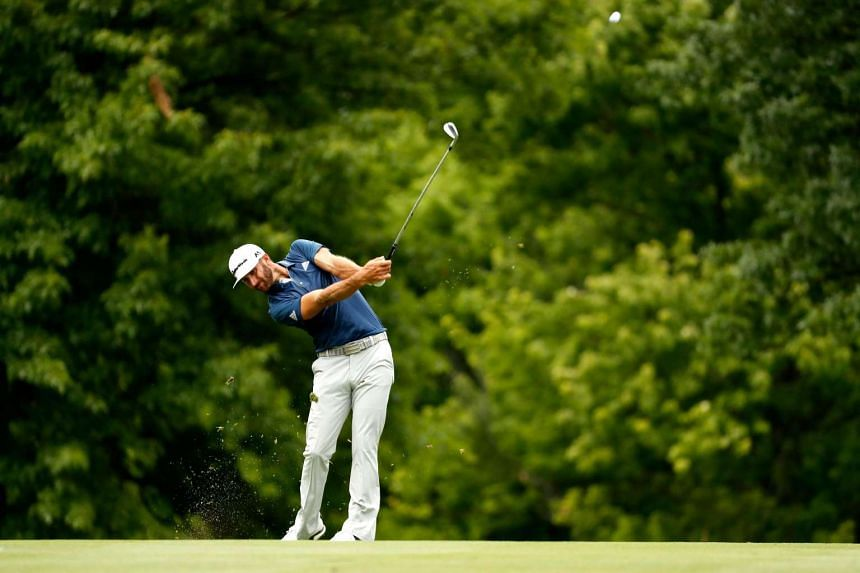Dustin Johnson plays a shot on the 11th hole during the final round of the World Golf Championships.