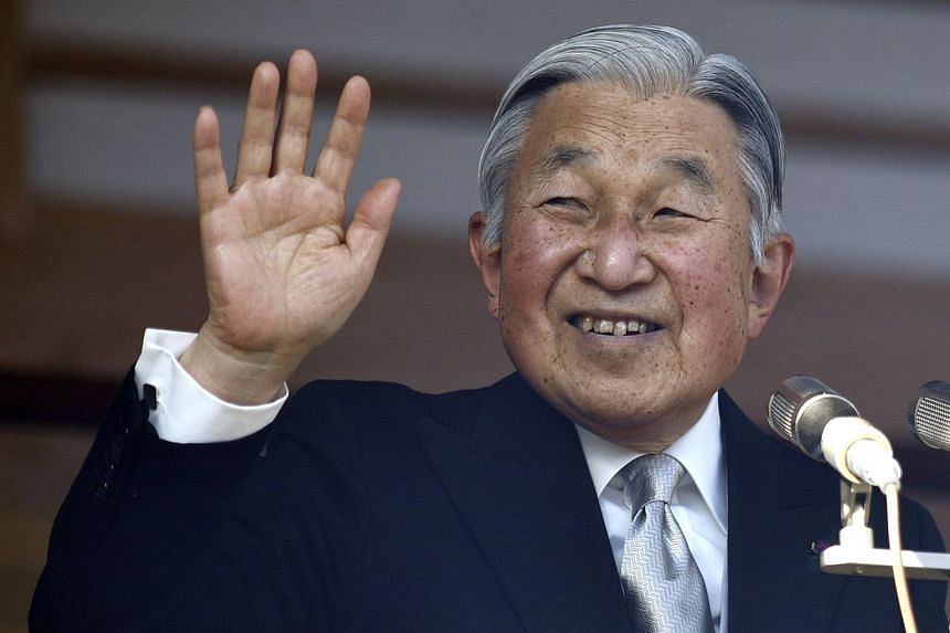 Japan's Emperor Akihito waves to well-wishers during the New Year's public appearance at the Imperial Palace in central Tokyo, Japan, on Jan 2.