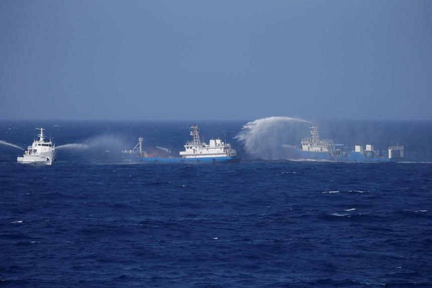Chinese ships during a search and rescue exercise near the Qilian Yu subgroup in the Paracel Islands, South China Sea, on July 14, 2016.