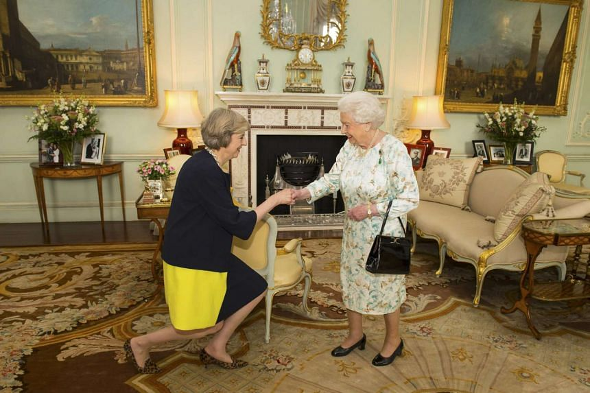 Britain's Queen Elizabeth welcomes Theresa May at Buckingham Palace, where she invited her to become Prime Minister.