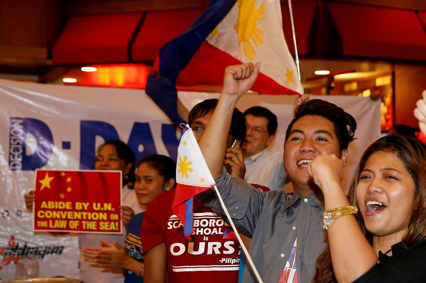 Activists react after a ruling on the disputed South China Sea by an arbitration court in Hague ruled in favor of Philippines on July 12.