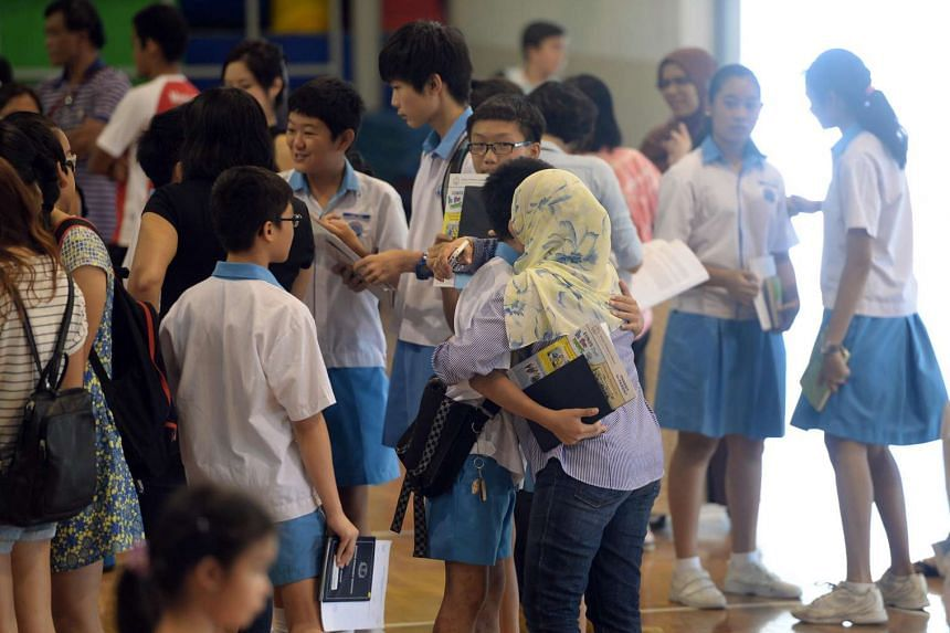 Eunos Primary School students receiving their PSLE results in 2015.