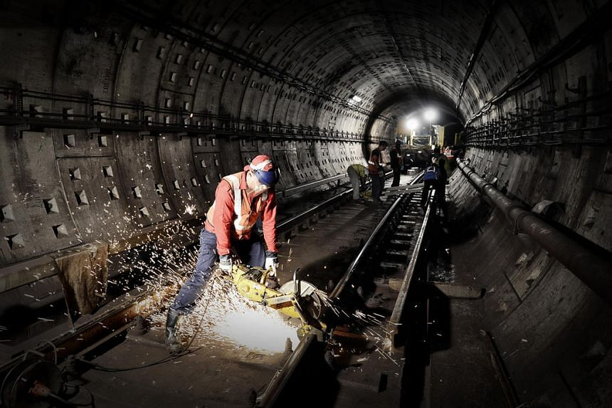 A SMRT employee working on the track replacement exercise on the North-South Line carried out by rail operator in late April 2013.