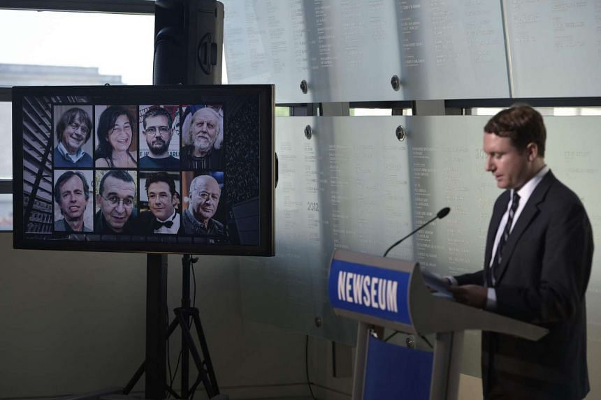 The images of French sartirical newspaper Charlie Hebdo journalists who were killed in a terrorist attack are seen during the re-dedication of the Newseum Journalists Memorial on June 6.