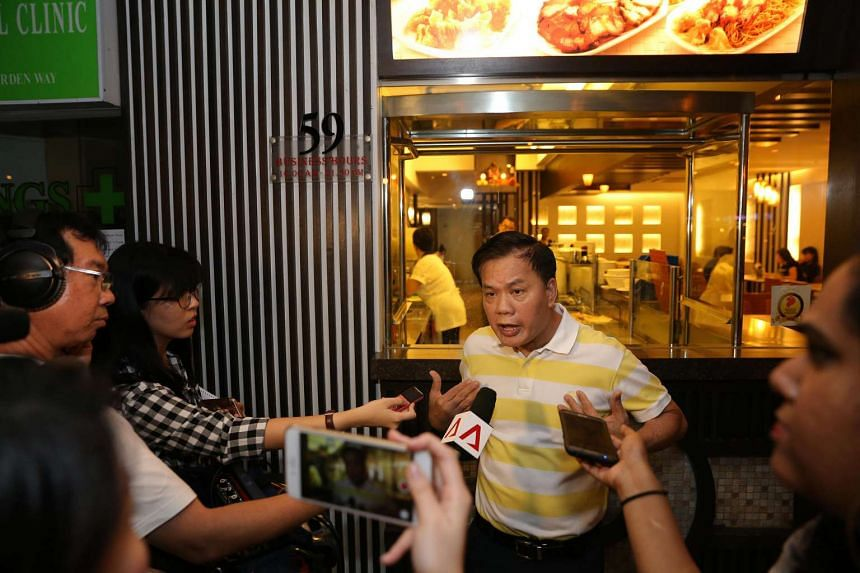 Pow Sing Restaurant's director Lee Chin Soo speaking to the media.