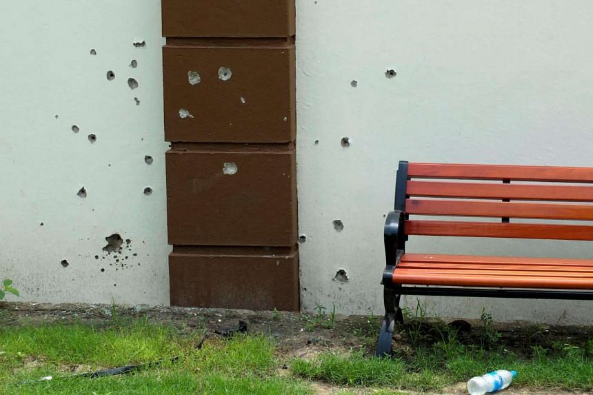 Bullet holes are seen on a wall following fighting outside the Presidential State House in South Sudan's capital Juba, on July 14, 2016.