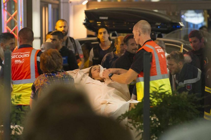 Emergency team members assist wounded people after a truck crashed into the crowd during the Bastille Day celebrations in Nice, France, on July 14, 2016.