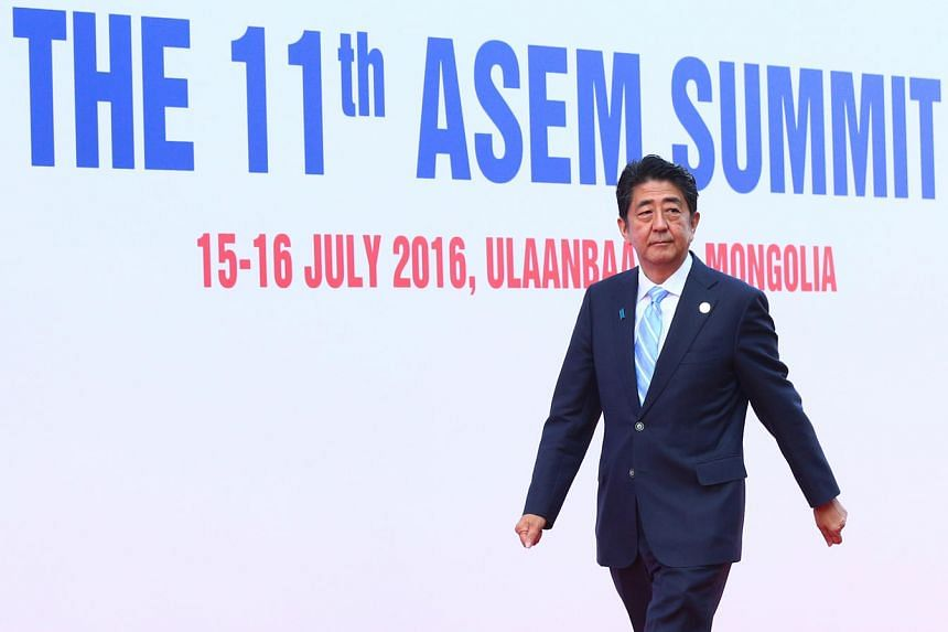 Japanese Prime Minister Shinzo Abe arrives for the 11th Asem Summit in the Mongolian capital of Ulaanbaatar, on July 15, 2016.