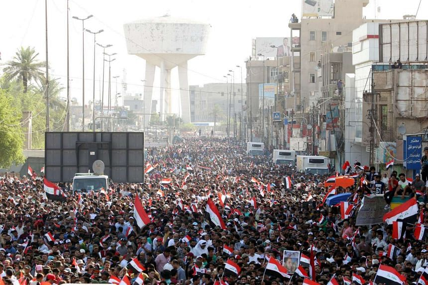 Supporters of Iraqi Shi'ite cleric Moqtada al-Sadr shout slogans during a protest against corruption at Tahrir Square in Baghdad, on July 15, 2016.