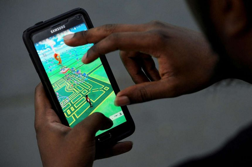 A virtual map of New York's Bryant Park is displayed on the screen as a man plays the augmented reality mobile game Pokemon Go.