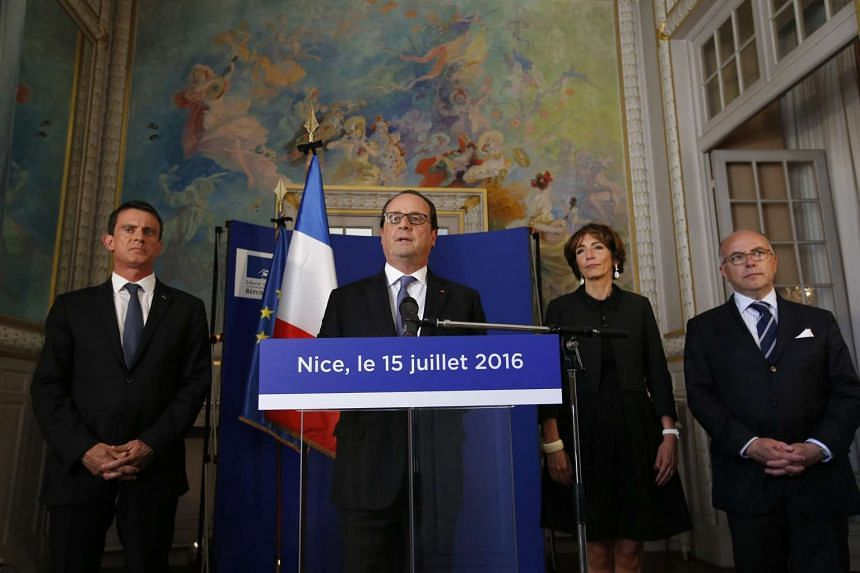 French President Francois Hollande (centre), flanked by French ministers, delivers a speech to police officers, firemen and rescue workers at the Prefectoral Palace in Nice, France, on July 15, 2016.