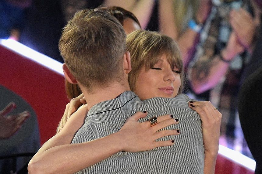 Calvin Harris tweeted that ex-girlfriend Taylor Swift is trying to make him look bad. Both are seen here at the iHeartRadio Music Awards in Inglewood, California, in April before they broke up.