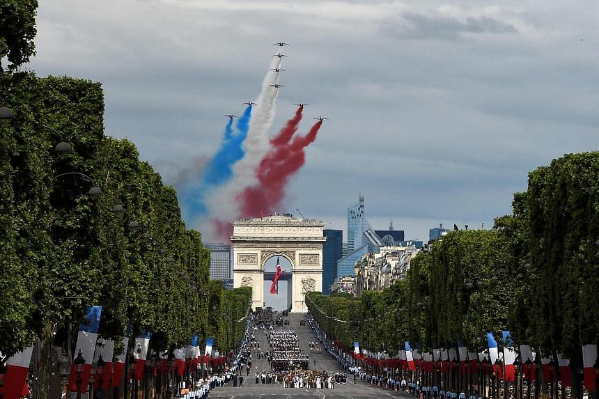Clockwise from above: Maori soldiers, Australian troops and Alphajet aircraft from French elite acrobatic flying team Patrouille de France taking part in the annual Bastille Day military parade on the Champs Elysees in Paris yesterday. Troops from Au