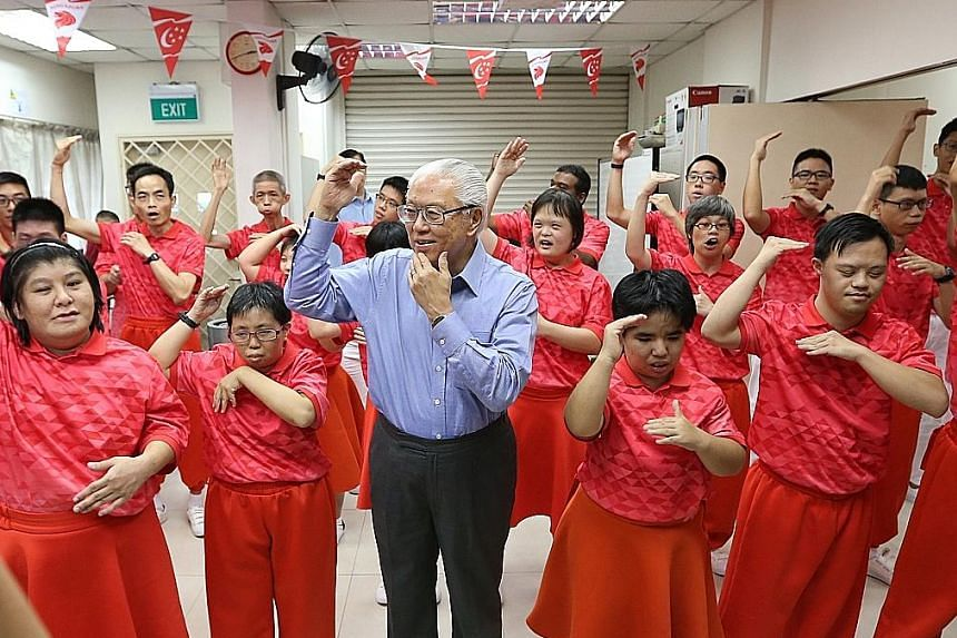 President Tony Tan at a song-signing rehearsal organised by Touch Community Services yesterday. The participants will lead the audience at the National Stadium in hand-signing to Home and Count On Me, Singapore.