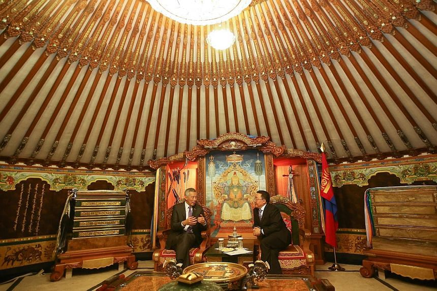 Prime Minister Lee meeting Mongolian President Tsakhia Elbegdorj at the State Palace in Mongolia yesterday. Mr Lee was also hosted to lunch by his Mongolian counterpart Jargaltulga Erdenebat, during which they affirmed the warm and friendly ties betw