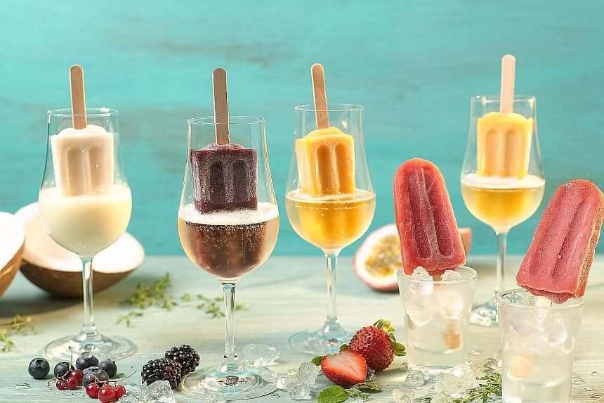 Fruity popsicles in glasses of booze ($6 a pop, and $18 with a glass of alcohol, above) at Grand Park Orchard hotel.
