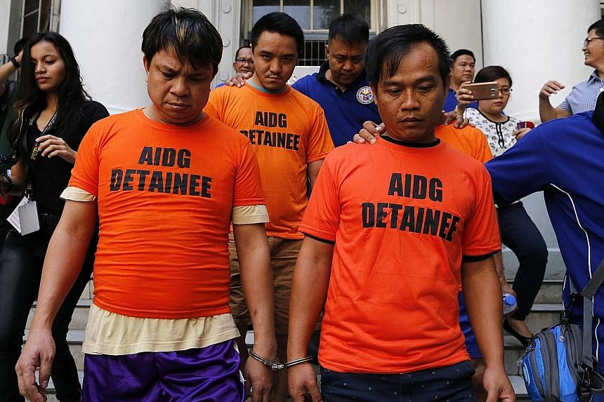 Alleged drug dealers from Hong Kong being escorted to inquest proceedings in Manila on Wednesday. The men were arrested during a raid at a seaport in Olongapo City, Zambales Province. Methamphetamines and equipment used to make illegal drugs were fou