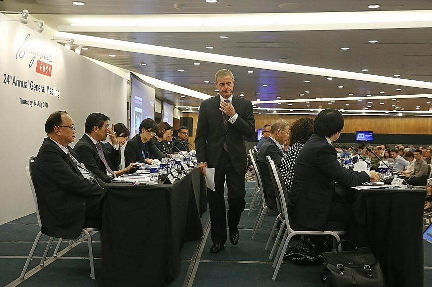 SingPost chairman Simon Israel preparing to deliver his speech at its 24th annual general meeting held yesterday at Suntec City Convention and Exhibition Centre. The meeting dragged into a three-hour affair as Mr Israel took pains to clear the air ov