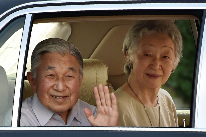 Japanese Emperor Akihito (left) and his wife Empress Michiko wave as they leave the imperial villa in Hayama, in Kanagawa prefecture, on July 14.