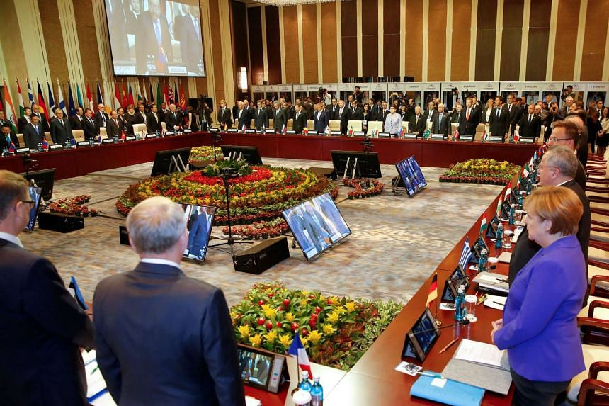 Leaders stand for a minute of silence for the victims of a deadly attack in the French city of Nice, before the opening session of the Asia-Europe Meeting (ASEM) summit in Ulaanbaatar, Mongolia on July 15.