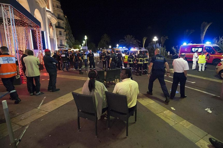Wounded people are evacuated from the scene where a truck crashed into the crowd during the Bastille Day celebrations in Nice,France on July 14.