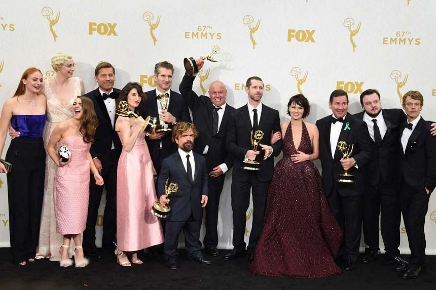 Cast members and others involved in the making of Game Of Thrones pose in 2015 after winning the Emmy for Outstanding Drama Series.