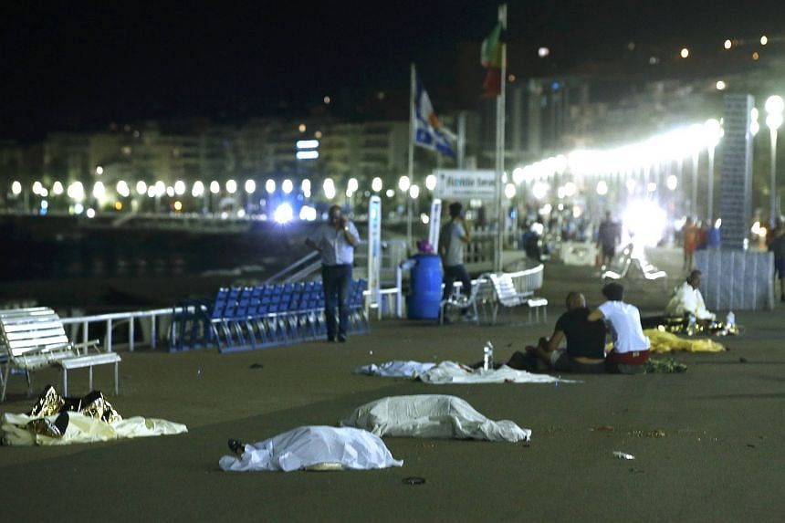 Bodies seen on the ground on July 15 after at least 30 people were killed in Nice, France, when a truck ran into a crowd celebrating the Bastille Day national holiday, on July 14.